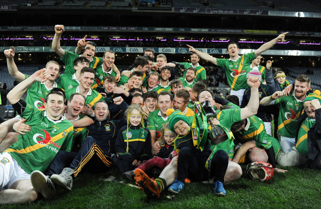 Carrickshock players and supporters celebrate with the cup
