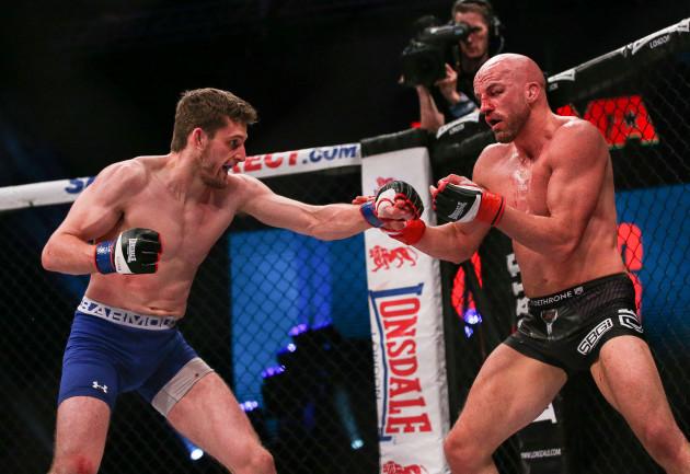 Peter Queally in action against Joe McColgan