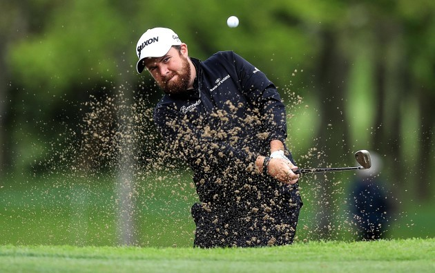 Shane Lowry plays his way out of a bunker on the fourth hole