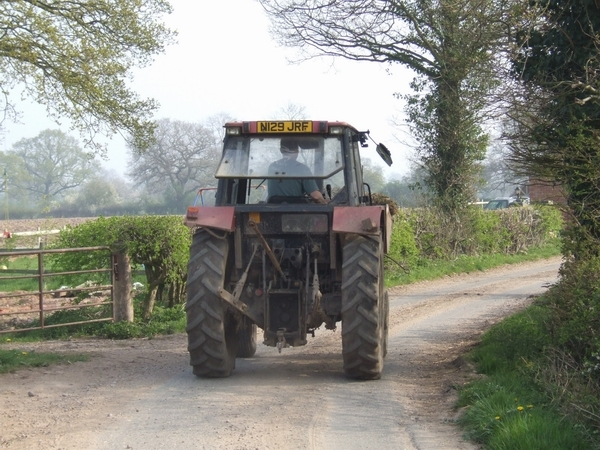 Tractor_on_the_road_from_Shredicote_Farm_-_geograph.org.uk_-_400942