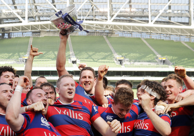 Ben Reilly lifts the Ulster Bank League trophy as his team celebrate winning