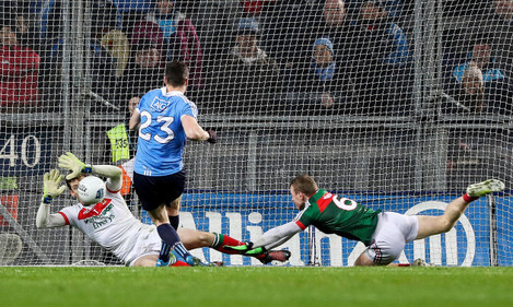 Paddy Andrews is denied by David Clarke straight after saving a penalty