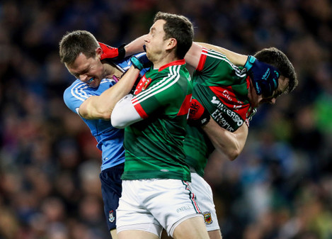Dean Rock gets in a tussle with Diarmuid O'Connor and Keith Higgins
