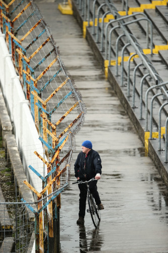 A Tipperary supporter watches the match from the terrace