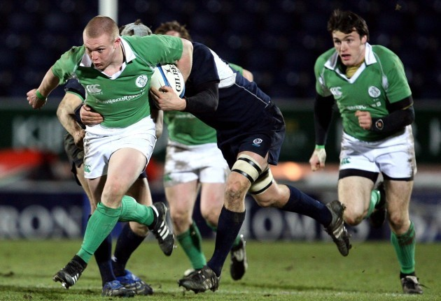 Keith Earls supported by Shane Monahan gets tackled by the Scottish defence