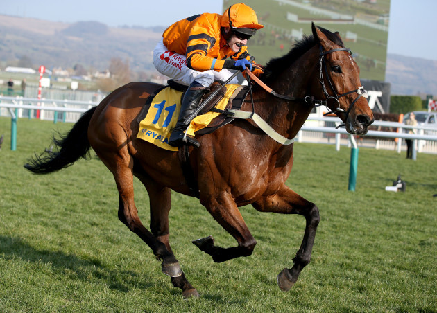Thistlecrack ridden by Tom Scudamore on the way to winning the Ryanair World Hurdle
