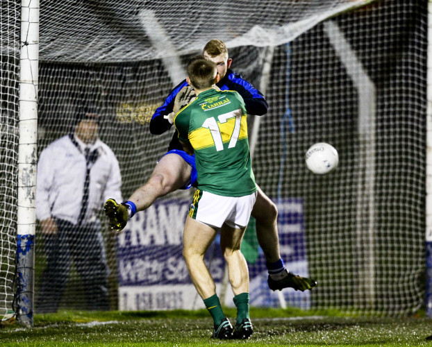Killian Spillane punches into the net for the first goal