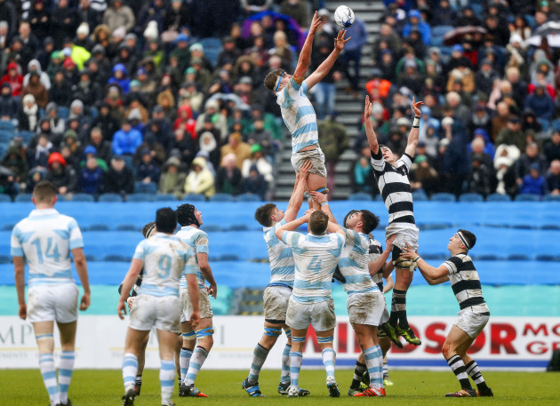 College's Charlie Ryan wins a lineout ahead of Oran O'Brien