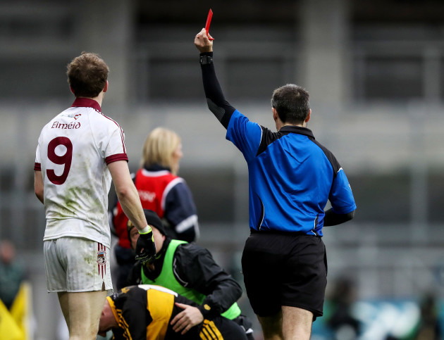Padraig Cassidy is red carded by Maurice Deegan
