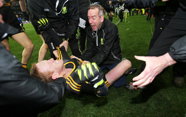 Colm Cooper celebrates with manager Pat O'Shea at the final whistle