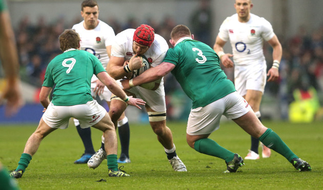 James Haskell tackled by Kieran Marmion and Tadhg Furlong