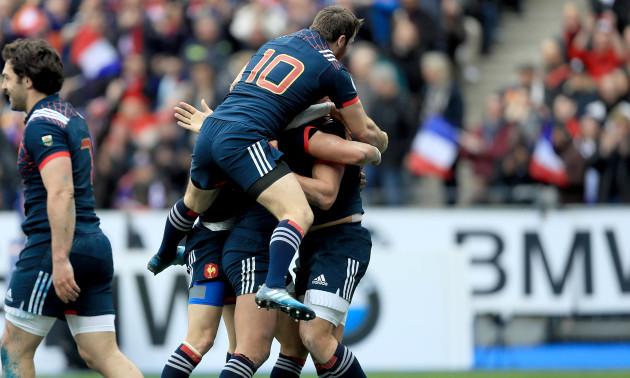 Remi Lamerat celebrates scoring a try with teammates