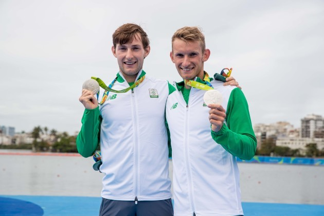 Gary and Paul O'Donovan celebrate winning a silver medal