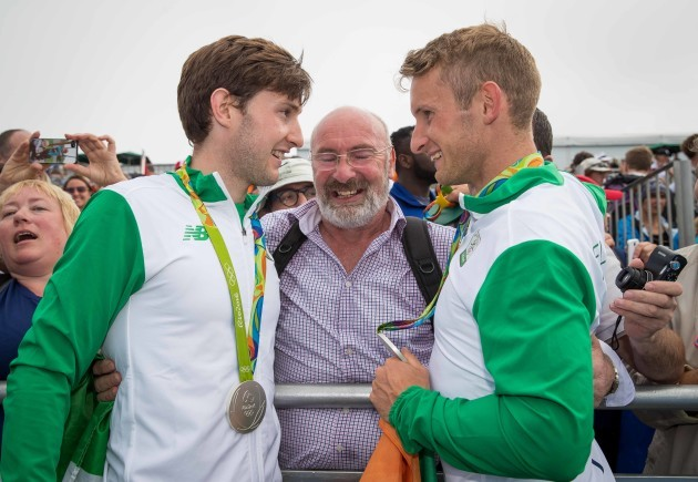 Paul and Gary O'Donovan celebrate winning a silver medal with father Teddy