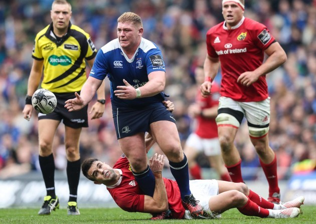 Leinster's Tadhg Furlong is tackled by Munster's Conor Murray