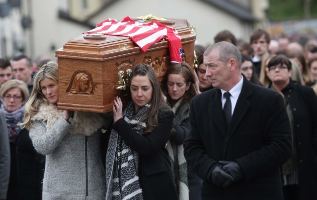 The remains of the late Derry City captain, Ryan McBride, are carried by his sisters Caitlin, Colleen, Siunin