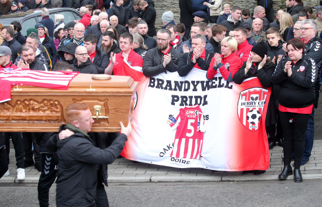 The remains of the late Derry City captain, Ryan McBride, are carried from the church after Requiem Mass