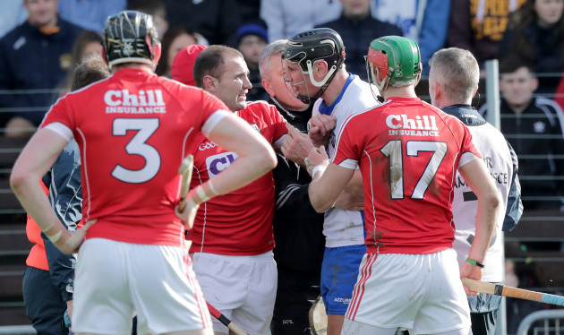 Maurice Shanahan confronts Dean Brosnan after being shown a red card