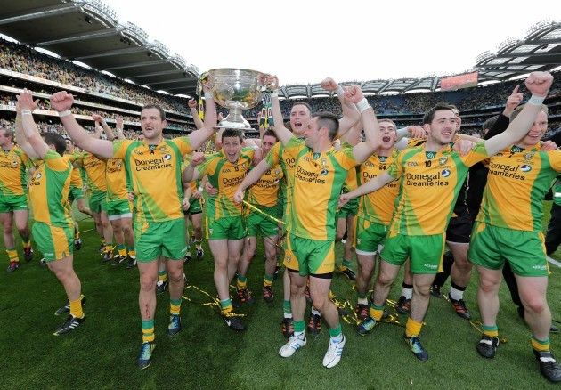 Donegal players celebrate with the Sam Maguire