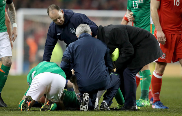 Shane Long with the injured Seamus Coleman