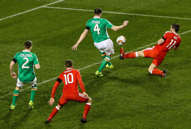 Gareth Bale is yellow carded for a high challenge on John O'Shea