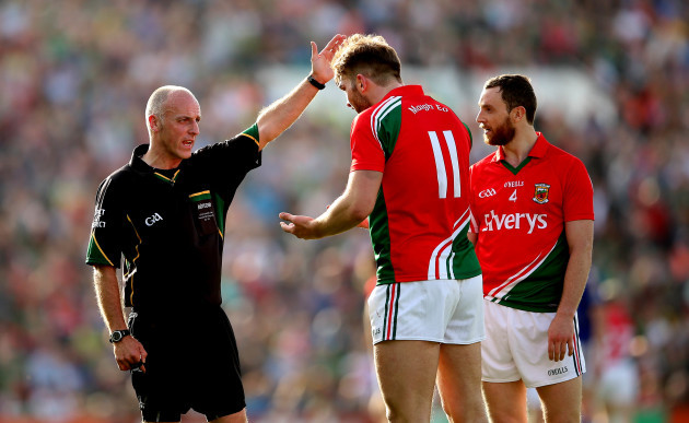 Aidan O'Shea and Keith Higgins speak with referee Cormac Reilly