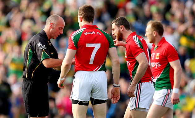 Donal Vaughan and Keith Higgins speak to referee Cormac Reilly