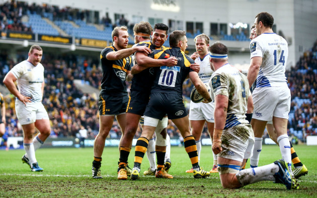 Jimmy Gopperth celebrates scoring his sides first try with Charles Piutau and Dan Robson
