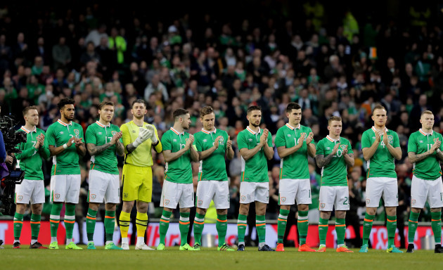 The Ireland team observe a minutes applause