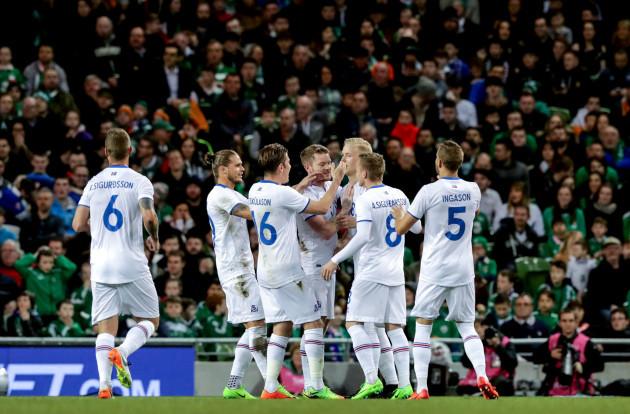Hordur Bjorgvin Magnusson celebrates scoring the first goal of the game with teammates