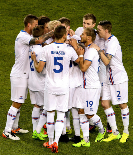 Hordur Bjorgvin Magnusson celebrates scoring a free kick with teammates