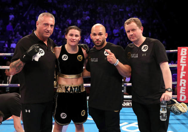 Katie Taylor with her team after the fight
