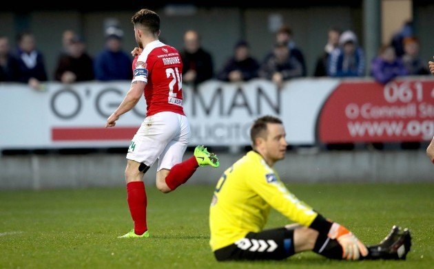 Sean Maguire celebrates scoring the first goal of the game as goalkeeper Brendan Clarke looks on dejected