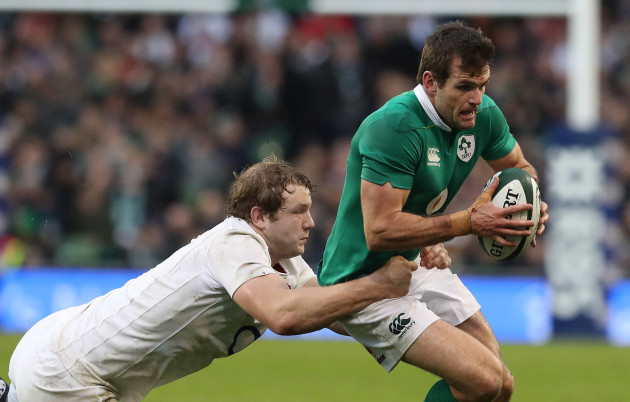 Ireland's Jared Payne is tackled by England's Joe Launchbury