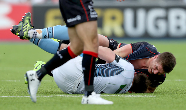 Ryan Wilson and Owen Farrell have a tussle