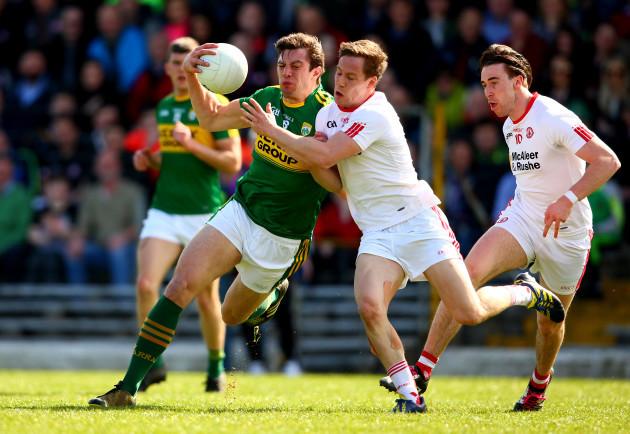 David Moran is tackled by Kieran McGeary