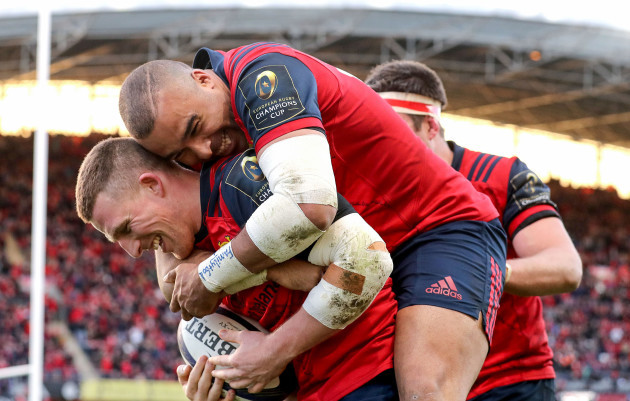 Andrew Conway celebrates his try with Simon Zebo