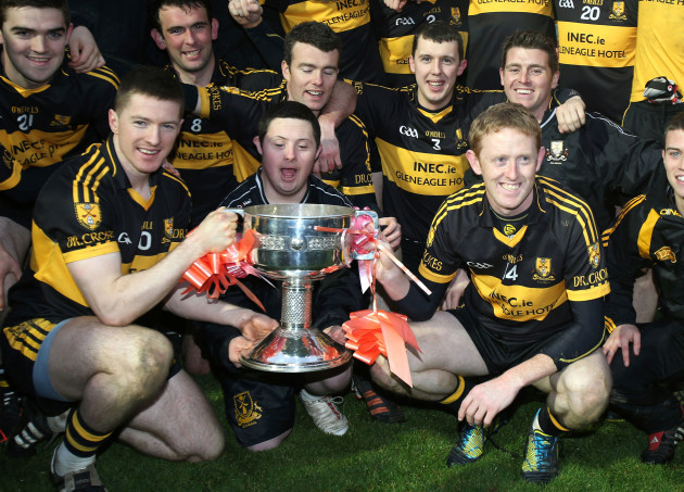 Kieran O'Leary and Colm Cooper hold the Bishop Moynihan cup