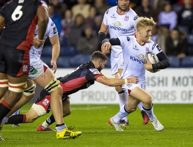 Rob Lyttle is tackled by Sean Kennedy
