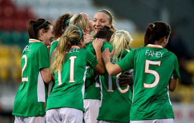 Stephanie Roche celebrates scoring a goal with teammates