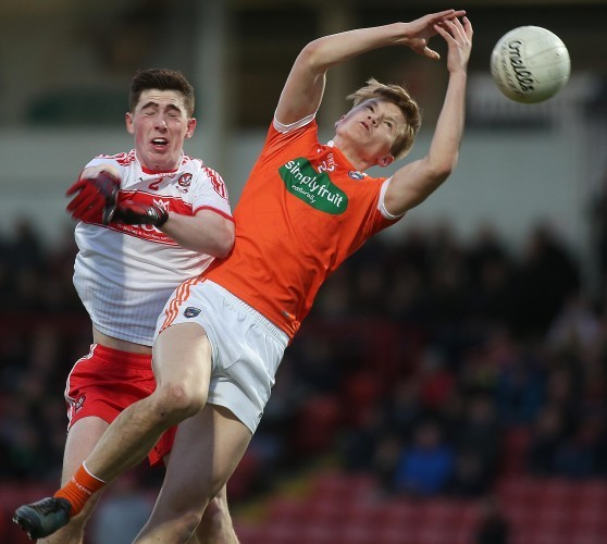 Armagh's Ryan O'Neill and Conor McGrogan of Derry