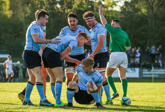 Tommy O'Brien celebrates scoring a try with teammates
