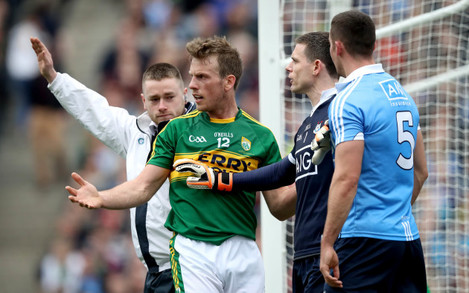 Stephen Cluxton and James McCarthy with Donnchadh Walsh