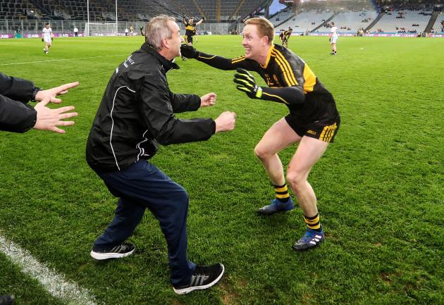 Colm Cooper celebrates with Pat O'Shea