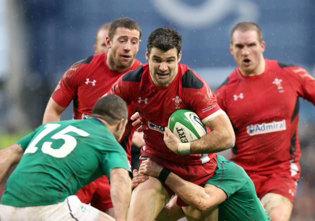 Mike Phillips is tackled by Conor Murray