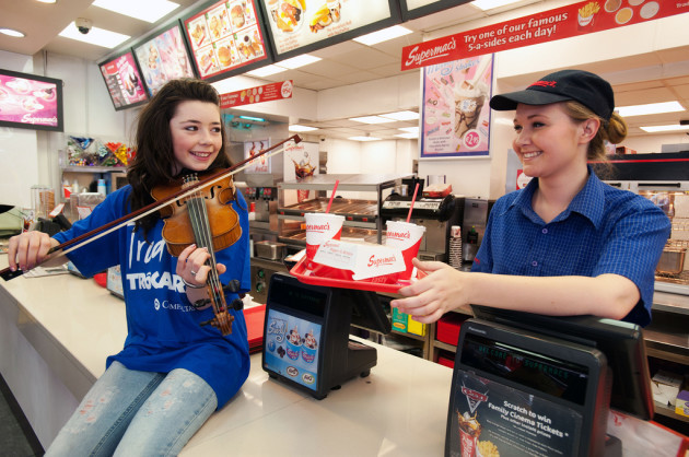 Ciara Murphy serves up some trad to Supermacs employee Stephanie Graham.