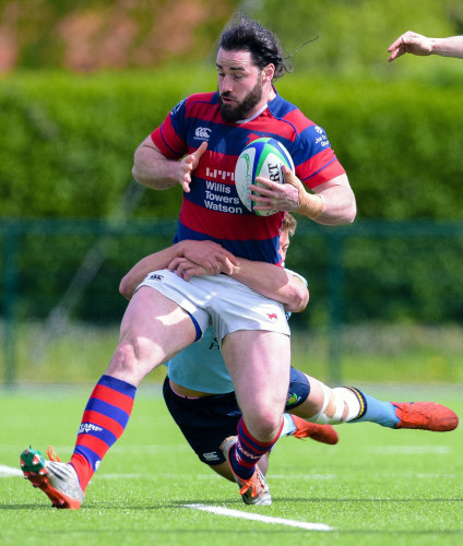 Mick McGrath is tackled by Rob Byrne