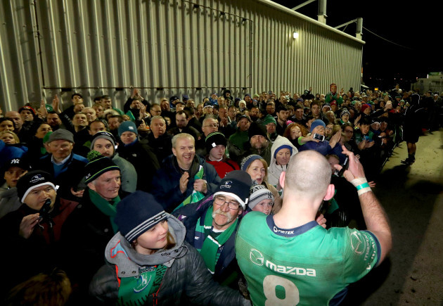 John Muldoon with fans after the game