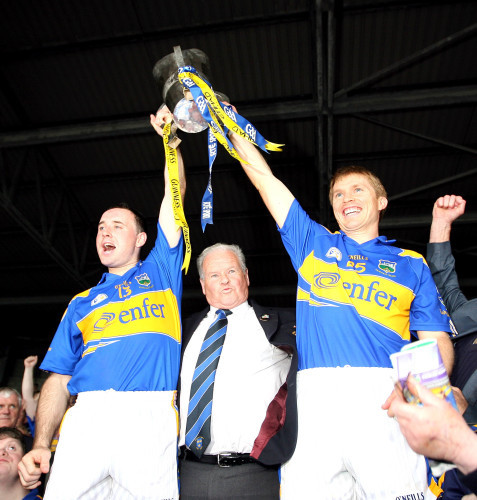 Joint captains Eoin Kelly and Paul Ormond lift the cup together