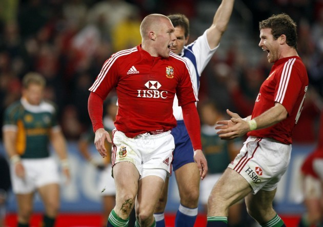 Keith Earls celebrates scoring his try with Gordon D'Arcy
